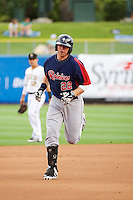 Justin Smoak (22) of the Tacoma Rainiers rounds the bases after hitting a home run against the Salt Lake Bees at Smith's Ballpark on July 9, 2014 in Salt Lake City, Utah.  (Stephen Smith/Four Seam Images)