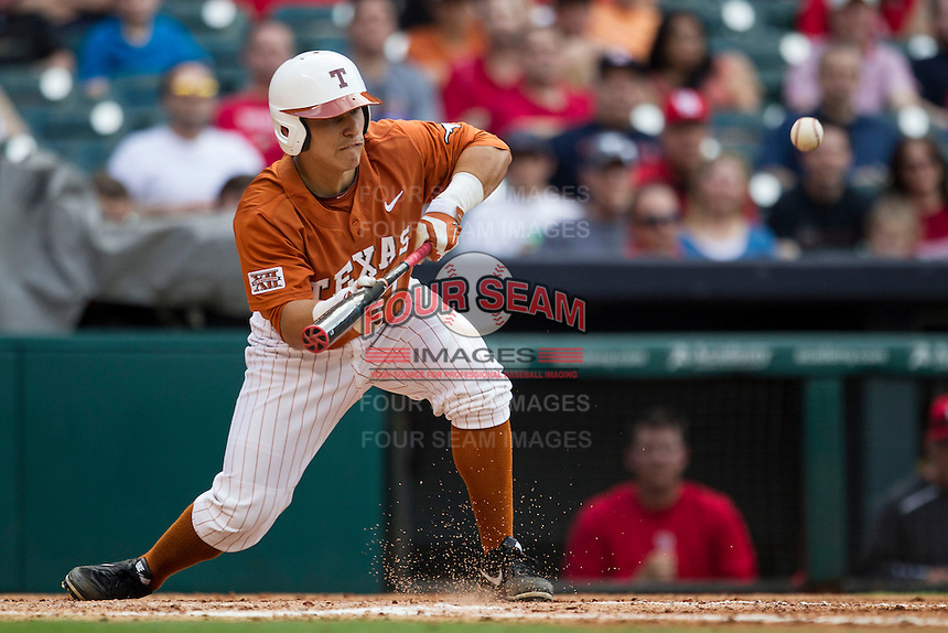Texas Longhorns designated hitter Tres Barrera #1 squares to bunt during the NCAA baseball game against the Houston Cougars on March 1, 2014 during the Houston College Classic at Minute Maid Park in Houston, Texas. The Longhorns defeated the Cougars 3-2. (Andrew Woolley/Four Seam Images)