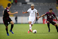 GUADALAJARA, MEXICO - MARCH 24: Julian Araujo #2 of the United States is defended by Alexis Vega #10 of Mexico during a game between Mexico and USMNT U-23 at Estadio Jalisco on March 24, 2021 in Guadalajara, Mexico.
