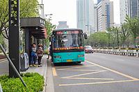 Suzhou, Jiangsu, China.  City Bus Stop and Bus.
