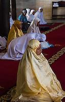 Yogyakarta, Java, Indonesia.  Women Awaiting Mid-day Prayers in the Great Mosque, Masjid Gedhe Kauman, mid-18th. Century.