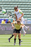 Shannon Boxx #7 of the Los Angeles Sol leaps over Tina Dimartino #5 of FC Gold Pride during their match at Home Depot Center on April 19, 2009 in Carson, California.