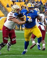 Pitt defensive lineman Jaylen Twyman (97) shoves aside Boston College center Alex Lindstrom (72).The Boston College Eagles defeated the Pitt Panthers 26-19 in the football game played at Heinz Field, Pittsburgh Pennsylvania on November 30, 2019.