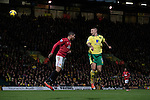 Norwich City 1 Manchester United 0, 17/11/2012. Carrow Road, Premier League. Home team's striker Anthony Pilkington (right) rising to head home the only goal of the match on 60 minutes at Carrow Road stadium, home of Norwich City as his team took on Manchester United in a Barclays Premier League fixture. The home team won the match by one goal to nil watched by a crowd of 26,840. It was Norwich City's first victory against Manchester United since 2005. Photo by Colin McPherson.