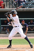Kelvin Castro #29 of the Charleston RiverDogs hitting during a game against the Rome Braves on April 27, 2010  in Charleston, SC.