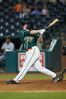 Gunnar Schubert (19) of the Greensboro Grasshoppers follows through on his swing against the West Virginia Power at First National Bank Field on August 9, 2018 in Greensboro, North Carolina. The Power defeated the Grasshoppers 9-7 in game two of a double-header. (Brian Westerholt/Four Seam Images)