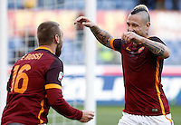 Calcio, Serie A: Roma vs Hellas Verona. Roma, stadio Olimpico, 17 gennaio 2016.<br /> Roma's Radja Nainggolan, right, celebrates with teammate Daniele De Rossi after scoring during the Italian Serie A football match between Roma and Hellas Verona at Rome's Olympic stadium, 17 January 2016.<br /> UPDATE IMAGES PRESS/Isabella Bonotto