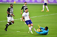 ORLANDO CITY, FL - JANUARY 31: Sebastian Lletget #17 of the United States takes a shot on Adrian Foncette #22 of Trinidad and Tobago during a game between Trinidad and Tobago and USMNT at Exploria stadium on January 31, 2021 in Orlando City, Florida.