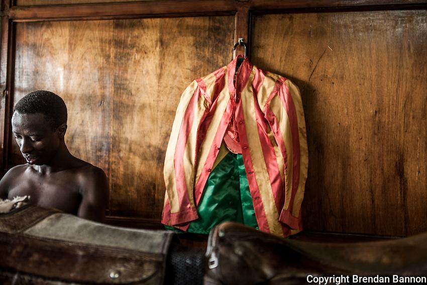 Jockey James Muhindi changes his colors between races at Ngong Racecourse in Nairobi, Kenya. March 17, 2013 Photo: Brendan Bannon