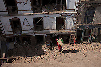 A Nepali woman taking out her belongings from her destroyed house at Kathmandu Durbar Square, Kathmandu, Nepal. May 03, 2015