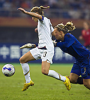 USA forward (13) Kristine Lilly moves past England goalkeeper (1) Rachel Brown for a goal. The United States (USA) defeated England (ENG) 3-0 during a quarter-final match of the FIFA Women's World Cup China 2007 at Tianjin Olympics Center Stadium in Tianjin, China, on September 22, 2007.