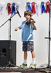 ROXBURY CT. 11 July 2015-071115SV04-Ian Fernandes, 11, of Woodbury plays during the annual Pickin' 'N' Fiddlin' fundraiser at Hurlburt Park in Roxbury Saturday.<br /> Steven Valenti Republican-American