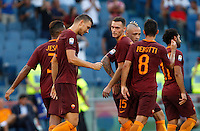 Calcio, Serie A: Roma vs Udinese. Roma, stadio Olimpico, 20 agosto 2016.<br /> Roma's Edin Dzeko, second from left, celebrates with teammates after scoring during the Italian Serie A football match between Roma and Udinese at Rome's Olympic Stadium, 20 August 2016. Roma won 4-0.<br /> UPDATE IMAGES PRESS/Riccardo De Luca