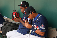 New Hampshire Fisher Cats pitcher Joel Carreno (left) and outfielder Kenen Bailli (right) clip their fingernails during a game against the Bowie Baysox at Prince George's Stadium on June 17, 2012 in Bowie, Maryland. New Hampshire defeated Bowie 4-3 in 13 innings. (Brace Hemmelgarn/Four Seam Images)