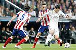 Real Madrid's James Rodriguez (r) and Atletico de Madrid's Tiago Mendes (l) and Saul Niguez during Champions League 2014/2015 Quarter-finals 2nd leg match.April 22,2015. (ALTERPHOTOS/Acero)