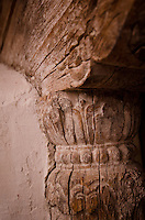 Close-up view of carved wood support pillar, Naropa Royal Palace, Shey, Ladakh, India.
