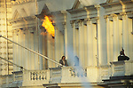 Iranian Embassy siege London England 5th May 1980. Armed SAS officers watch s a hostage escapes from burning building. The Iranian hostage-takers had opposed Ayatollah Khomeini and demanded freedom for the southern Iranian province of Khuzestan. But their cause was soon forgotten when war broke out between Iran and Iraq in late 1980 - a conflict that was to last eight years.