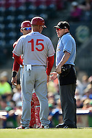 Hagerstown Suns catcher Spencer Kieboom (20) and manager Patrick Anderson (15) argue a call with home plate umpire Cody Waterhouse during a game against the Lexington Legends on May 19, 2014 at Whitaker Bank Ballpark in Lexington, Kentucky.  Lexington defeated Hagerstown 10-8.  (Mike Janes/Four Seam Images)