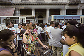 Parents wait in central Havana for the departure of buses taking their children for one month's work on the tobacco harvest in Pinar Del Rio province.