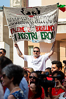 "Palermo (Sicily - Italy), 19/07/2017. ""Basta depistaggi e omertà di Stato!"" (""Stop red herrings and State's omertá! - ""omertá is - among the Mafia - a code of silence about criminal activity and a refusal to give evidence to the police"" - Source Oxforddictionaries.com) Today, to commemorate the 25th Anniversary of the assassination of the anti-mafia Magistrate Paolo Borsellino and the five members of Borsellino's police ""scorta"" (escorts from the special branch of the Italian police force who protect Judges) Agostino Catalano, Emanuela Loi (the first Italian female member of the police special branch and the first one to be killed on duty), Vincenzo Li Muli, Walter Eddie Cosina and Claudio Traina a public event was held in Via D'Amelio. Family members of mafia's victims, amongst others, made speeches about their dramatic experiences, mafia's violence and unpunished crimes, and State's misdirection, silence, red herrings. Speakers included, amongst others, Vincenzo Agostino & Augusta Schiera, Salvatore & Cristina & Antonella Catalano, Graziella Accetta & Ninni Domino, Massimo Sole, Paola Caccia, Luciano Traina, Gianluca & Angela Manca, Nunzia & Stefano Mormile, Ferdinando Imposimato, Judge Nino Di Matteo. The event ended with the screening of the docufiction RAI 'Adesso Tocca A Me' (Now it is my turn - Watch it here: http://bit.ly/2w3WJUX) by G. Filippetto & F. Miccichè.<br />
