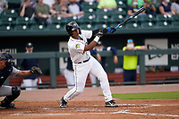 First baseman Felix Familia (24) of the Columbia Fireflies in a game against the Charleston RiverDogs on Tuesday, May 11, 2021, at Segra Park in Columbia, South Carolina.  The catcher is Jonathan Embry (1). (Tom Priddy/Four Seam Images)