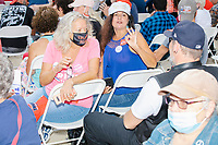 People wearing Trump campaign shirts and hats gather before Donald Trump, Jr., son of president Donald Trump and a rising Republican political star, speaks at an outdoor campaign rally at The Lobster Trap in North Conway, New Hampshire, on Thu., Sept. 24, 2020.