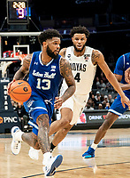 WASHINGTON, DC - FEBRUARY 05: Myles Powell #13 of Seton Hall moves away from Jagan Mosely #4 of Georgetown during a game between Seton Hall and Georgetown at Capital One Arena on February 05, 2020 in Washington, DC.