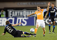 28 March 2009: Kelly Gray of Earthquakes tries to tackle the ball against Brian Mullan of Dynamo during the game at Buck Shaw Stadium in Santa Clara, California.  San Jose Earthquakes defeated Houston Dynamo, 3-2.