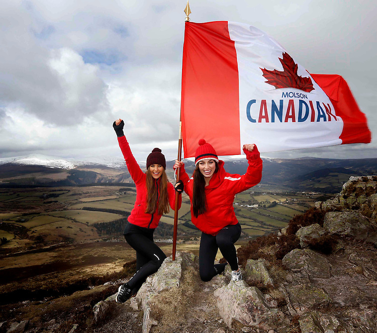No Repro Fee..For shots featuring just Roz and Daniella with flag and pole (0393, 0329).THE ADVENTURE STARTS HERE - CANADIAN LANDS IN IRELAND!.Models Roz Purcell and Daniella Moyles plant the 'Canadian' flag at the top of the Sugarloaf mountain to mark the much anticipated arrival of Molson Canadian lager in Ireland. Molson Canadian is Canada's most iconic and exciting lager brand. Its launch in Ireland represents the biggest lager launch here in over ten years and the first time ever that Molson Canadian has launched outside North America.Pic. Robbie Reynolds