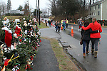 NEWTOWN, CT-17 December 2012-121712LW14 - Mourners comfort each other at the evergreen memorials near the entrance of Sandy Hook Elementary School  in Newtown Monday. Laraine Weschler