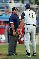 August 3rd 2008:  Home plate umpire Jose Esteras listens to Sid Bream, interm manager of the State College Spikes, argue a call during a game at Dwyer Stadium in Batavia, NY.  Photo by:  Mike Janes/Four Seam Images