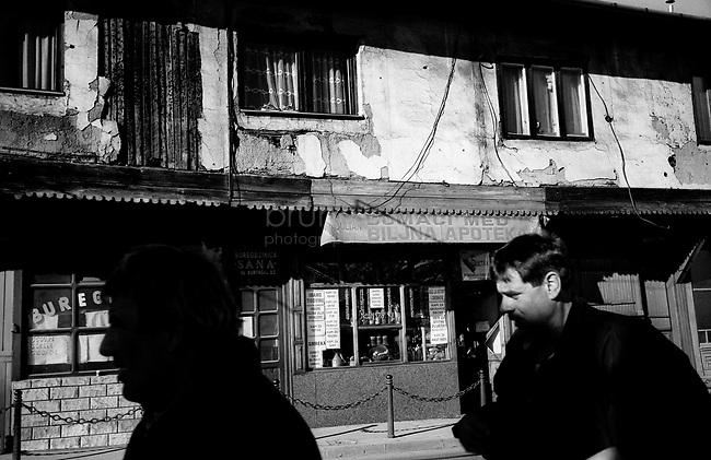 BOSNIA-HERZEGOVINA, Sarajevo, March 2003..10 years after the end of the war, I came for the first time in Sarajevo. I have in mind the images of the besieged city. The daily death, the impotence and the guilty inaction of the international community, the sad spectacle of a war in Europe. 10 years later, I walk the streets obsessed with the scars of war..In the historical center..BOSNIE-HERZEGOVINE, Sarajevo, Mars 2003..10 ans après la fin de la guerre, j'arrive pour la première fois à Sarajevo. J'ai encore en tête les images de la ville assiégée. La mort quotidienne, l'impuissance voire l'inaction coupable de la communauté internationale, le spectacle désolant d'une guerre en Europe. 10 après, je déambule dans les rues obsédé par les stigmates de la guerre..Dans le centre historique..© Bruno Cogez