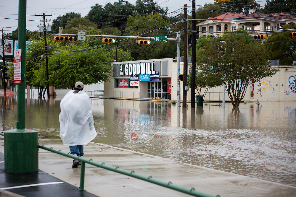 A fast-moving storm packing heavy rain and destructive winds has overwhelmed rivers and prompted evacuations in the same area southwest of Austin that saw devastating spring floods.