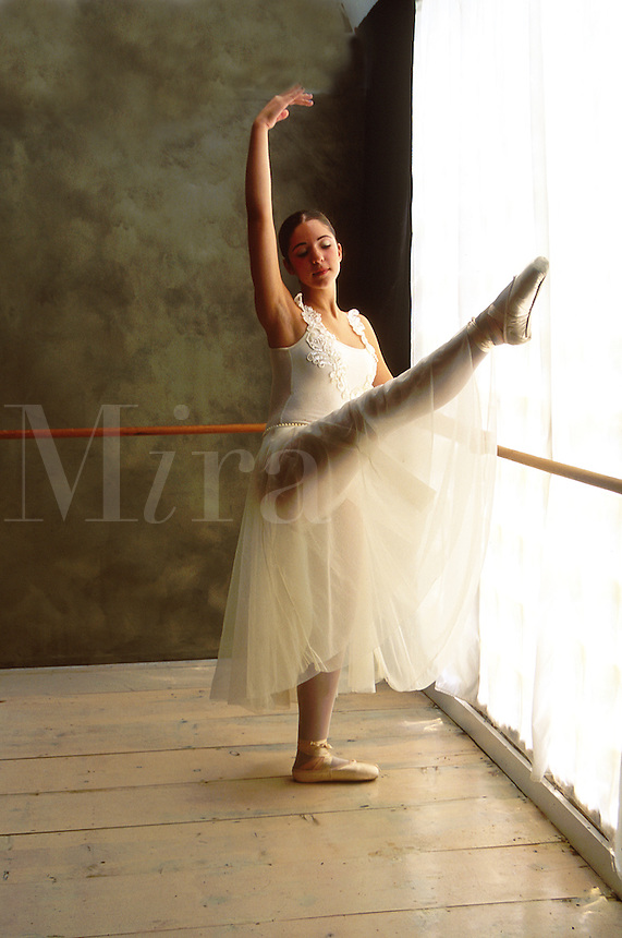 Young ballerina dancing in studio