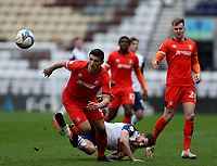20th March 2021; Deepdale Stadium, Preston, Lancashire, England; English Football League Championship Football, Preston North End versus Luton Town; Ched Evans of Preston North End is upended by Matty Pearson of Luton Town