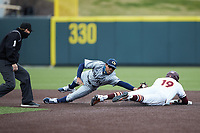 Gavin Cross (19) of the Virginia Tech Hokies slides into second base ahead of the tag by Austin Wilhite (14) of the Georgia Tech Yellow Jackets at English Field on April 17, 2021 in Blacksburg, Virginia. (Brian Westerholt/Four Seam Images)