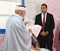 Ennahdha's presidential candidate Abdelfattah Mourou casts his ballot for presidential election at a polling station in La Marsa on the outskirts of the capital Tunis on September 15, 2019. - Rarely has the outcome of an election been so uncertain in Tunisia, the cradle and partial success story of the Arab Spring, as some seven million voters head to the polls today to choose from a crowded field.