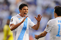 Carlos Gallardo (5) of Guatemala  celebrates scoring with Marco Pappa (16). Guatemala defeated Grenada 4-0 during a CONCACAF Gold Cup group stage match at Red Bull Arena in Harrison, NJ, on June 13, 2011.