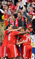 02 May 2009: Toronto FC players celebrate a goal by Chad Barrett #19 at BMO Field in a game between the Columbus Crew and Toronto FC. .The game ended in a 1-1 draw...