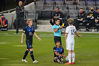SAN JOSE, CA - OCTOBER 28: Referee Elton Garcia issues a yellow card to Nick Besler #13 of Real Salt Lake during a game between Real Salt Lake and San Jose Earthquakes at Earthquakes Stadium on October 28, 2020 in San Jose, California.