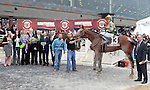 DONE TALKING and jockey Sheldon Russell in the winner's circle for the GIII TVG Illinois Derby at Hawthorne Race Course in Cicero/Stickney, IL.