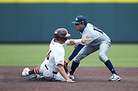 Austin Wilhite (14) of the Georgia Tech Yellow Jackets applies  the tag to Kevin Madden (26) of the Virginia Tech Hokies as he slide into second base at English Field on April 17, 2021 in Blacksburg, Virginia. (Brian Westerholt/Four Seam Images)