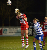 20140221 - OOSTAKKER , BELGIUM : Antwerp Sophie Mannaert (l) pictured with the header in front of Gent Jassina Blom (r)  during the soccer match between the women teams of AA Gent Ladies  and RAFC Antwerp Ladies , on the 19th matchday of the BeNeleague competition Friday 21 February 2014 in Oostakker. PHOTO DAVID CATRY