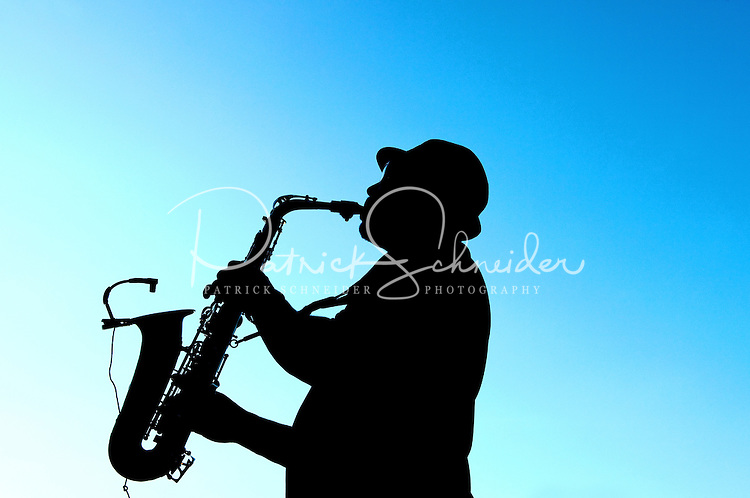 Photography of an event at the Ballantyne Hotel & Lodge in Charlotte, NC. Ballantyne Hotel is a member of the Starwood Hotels & Resorts, is a Forbes Four-Star and AAA Four-Diamond hotel. The sax player was part of the entertainment.