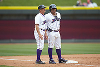 Winston-Salem Dash manager Omar Vizquel (left) chats with Yermin Mercedes (6) at third base during the game against the Salem Red Sox at BB&T Ballpark on April 22, 2018 in Winston-Salem, North Carolina.  The Red Sox defeated the Dash 6-4 in 10 innings.  (Brian Westerholt/Four Seam Images)