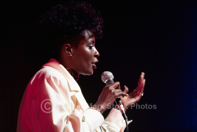 Portrait of African American Woman, Black Female Singer singing with Microphone (No Model Release Available)