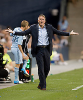 Head coach of Sporting Kansas City, Peter Vermes, questions a referees call during the game at Livestrong Sporting Park in Kansas City, Kansas.  D.C. United lost to Sporting Kansas City, 1-0.