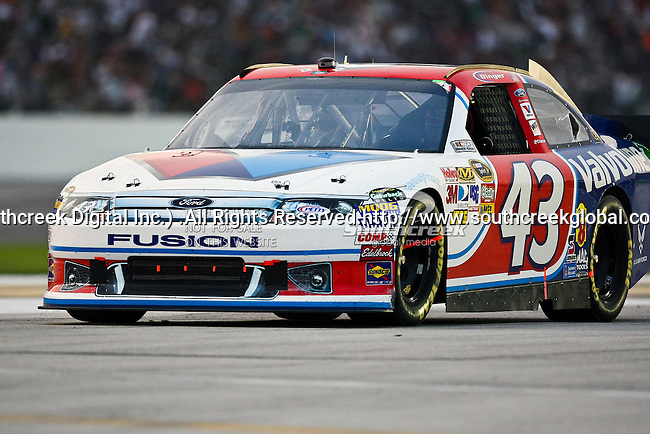 A.J. Allmendinger, driver of the (43) Valvoline Ford, in action during the Samsung Mobile 500 Sprint Cup race at Texas Motor Speedway in Fort Worth,Texas.