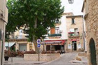 The main village square with cafes and restaurants. St Jean de Fos village. Languedoc. France. Europe.