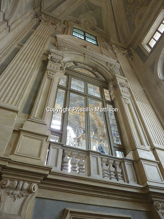 Turin, Italy - February 4, 2012:  A tall internal window looks out over the staircase of the Palazzo Madama.